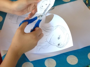 A ten year old creates her vision of Alice for a take of Alice in Wonderland. The Italian kids were completely absorbed in the artistic craft activities.